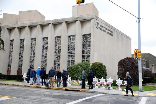 Mourners visit the Tree of Life Synagogue on Oct. 29, 2018, in the Squirrel Hill neighborhood of Pittsburgh after 11 were killed and six others were wounded Saturday.