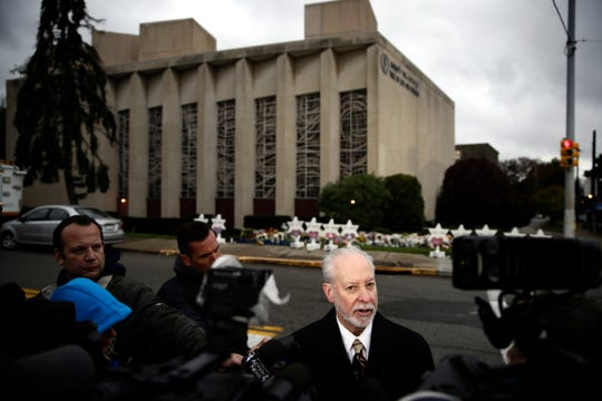 Rabbi Jeffrey Myers of the Tree of Life/Or L'Simcha Congregation stands across the street from the synagogue in Pittsburgh, Monday, Oct. 29, 2018. Shooting suspect Robert Gregory Bowers is expected to appear in federal court Monday. Authorities say he expressed hatred toward Jews during the rampage Saturday morning and in later comments to police.