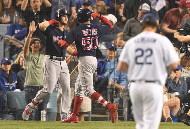 Game 5 at Dodger Stadium: Mookie Betts celebrates with Andrew Benintendi after hitting a solo home run in the sixth.