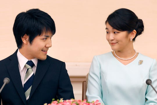 Japan's Princess Mako, eldest granddaughter of Emperor Akihito, and her fiance Kei Komuro, during a press conference in Tokyo. Their wedding, planned for November, will be delayed until 2020, citing lack of time for preparations.