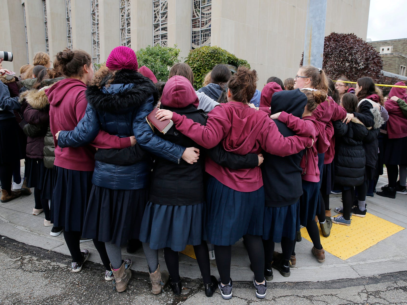 Students from the Yeshiva Girls High School sing outside of the Tree of Life Congregation synagogue of Pittsburgh on Oct. 29, 2018.