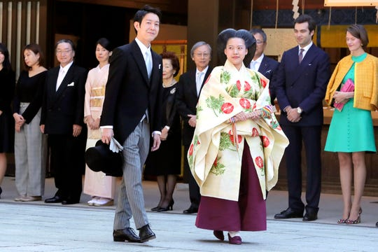 Japanese Princess Ayako, dressed in traditional ceremonial robe, and groom Kei Moriya, arrive at Meiji Shrine for their wedding ceremony in Tokyo, Oct. 29, 2018.