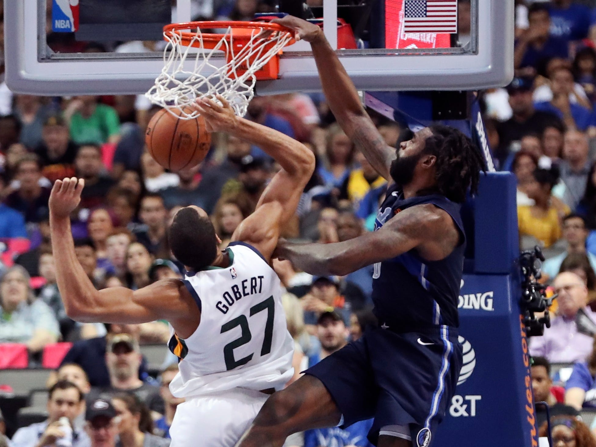 Oct. 28: Mavericks center DeAndre Jordan (6) hammers home a one-handed flsuh over Jazz defender Rudy Gobert (27) in Dallas.