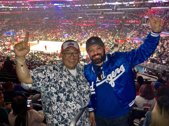 Los Angeles sports fans Doane Liu, left, and Branimir Kvartuc at the game between the Wizards and Clippers at the Staples Center. They planned to experience LA's so-called 'sports equinox.'