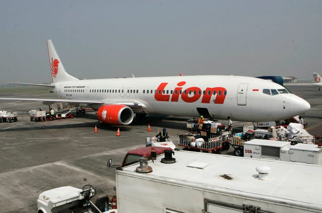 A Lion Air jet is seen on the tarmac at Juanda International Airport in Surabaya, Indonesia in 2012. One of the low-cost airline's planes crashed off the coast of Jakarta Monday.