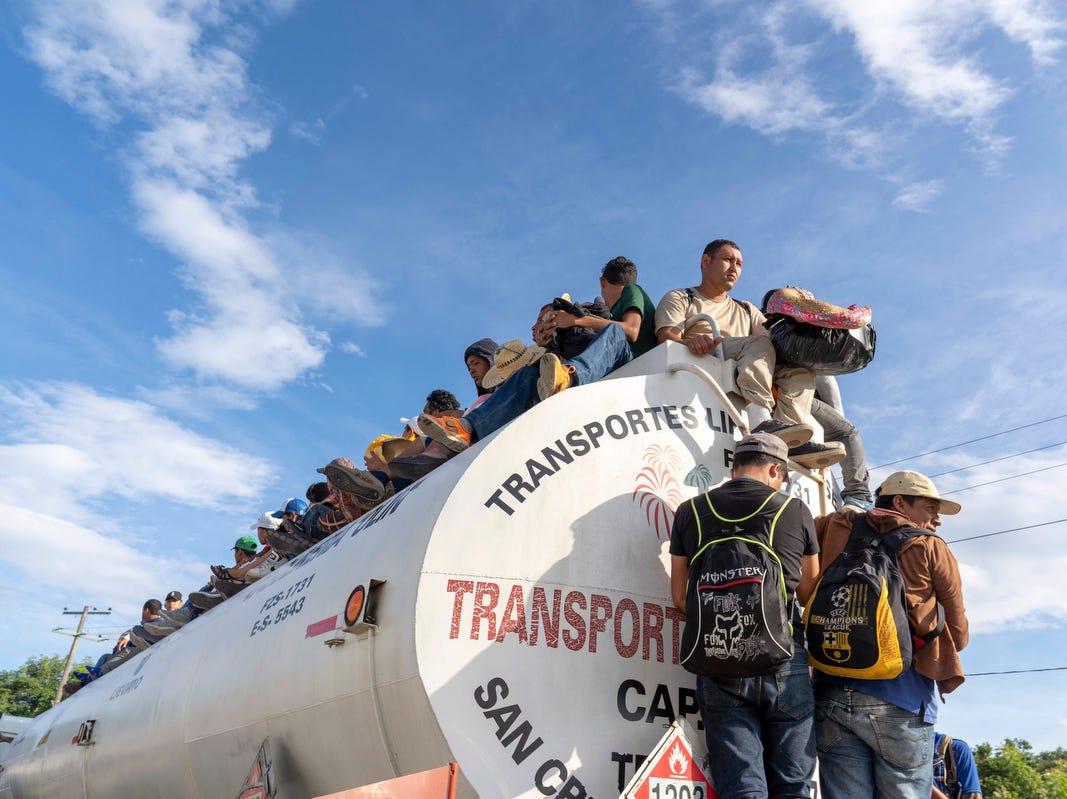 Migrants hitch rides on trucks in Tapanatepec, Oaxaca, Mexico, Monday.