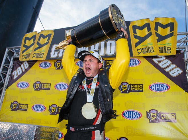 NHRA Top Fuel driver Steve Torrence celebrates after clinching the championship.