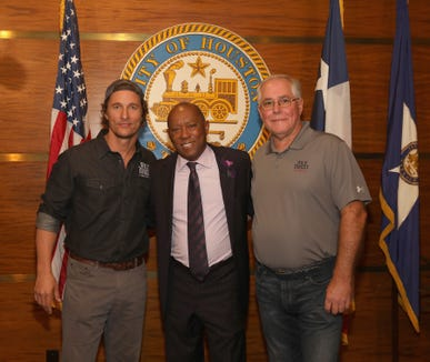 (L-R) Matthew McConaughey, Houston's Mayor Sylvester Turner and Wild Turkey's Eddie Russell take photos during Wild Turkey gives back 2018 on October 28, 2018 in Houston, Texas.