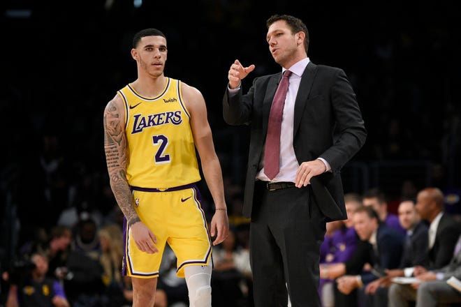 Lakers head coach Luke Walton talks with guard Lonzo Ball during the second half against the Denver Nuggets.