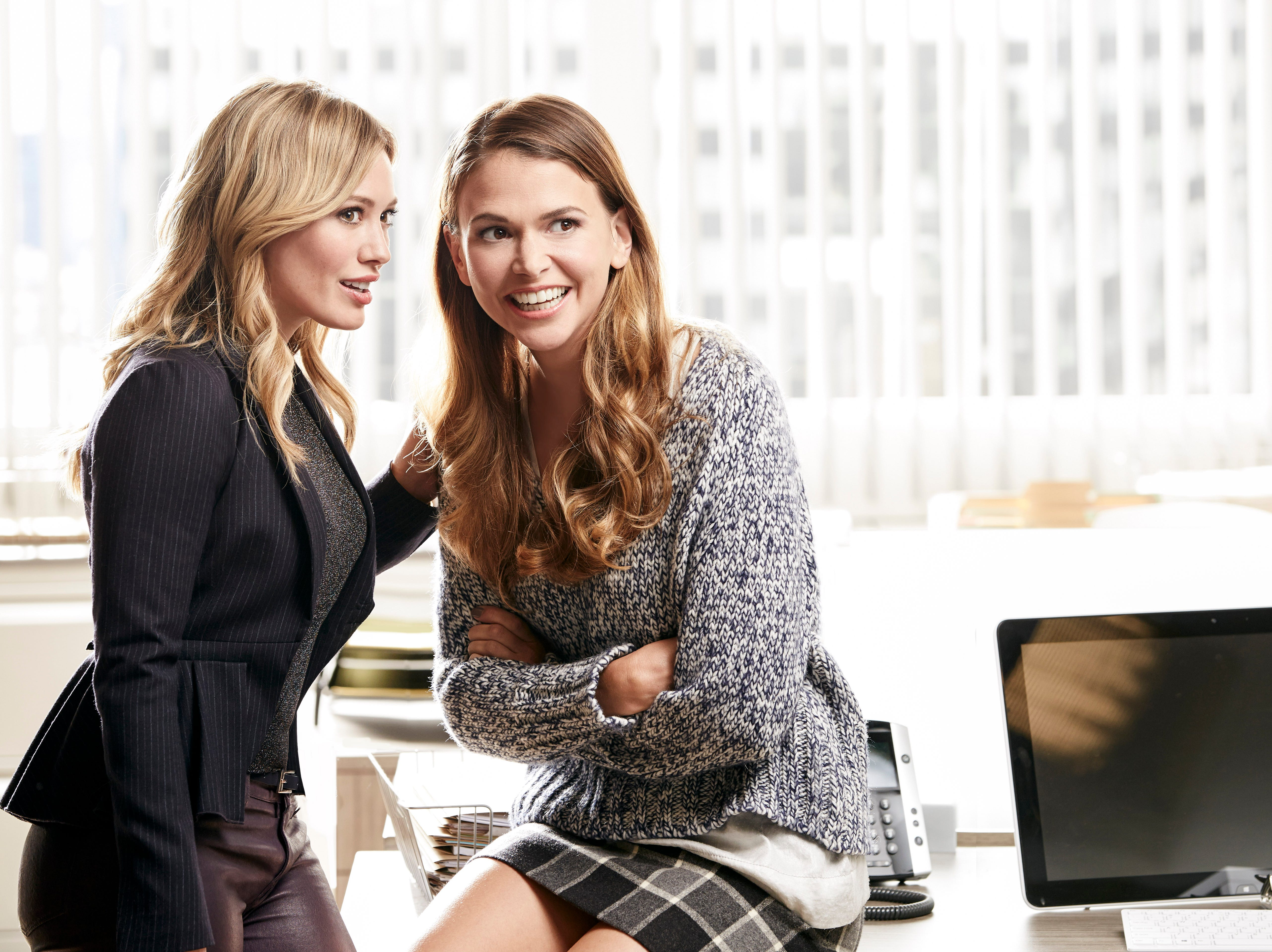 """Younger"" Premieres March 31, 2015 Kelsey (left: Hilary Duff) gives Liza (Sutton Foster) a few tips about Empirical Press, the publishing firm where they work. ÒYoungerÓ is TV LandÕs new single-camera comedy premiering on March 31, 2015. credit: TV Land"
