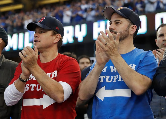 Matt Damon and Jimmy Kimmel watch Game 5 of the World Series.