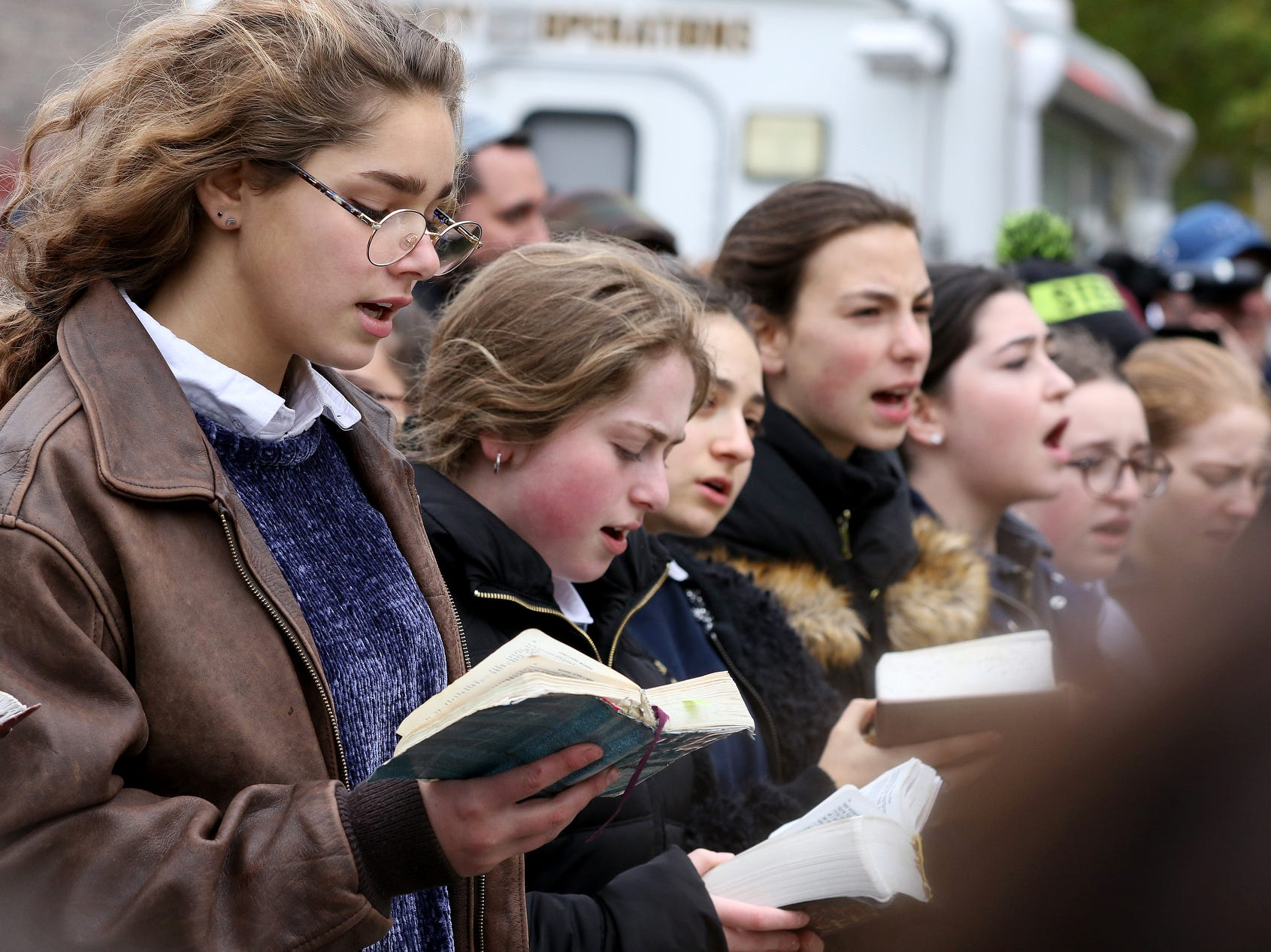Students from Yeshiva Girls High School pray, on Oct. 29, 2018, outside of the Tree of Life Congregation Synagogue in  Pittsburgh, Pa. Robert Bowers allegedly screamed anti-Semitic epithets, as he opened fire on the congregants of Tree of Life during a service, law enforcement officials said. Eleven worshippers were killed and  six other people were wounded Saturday.