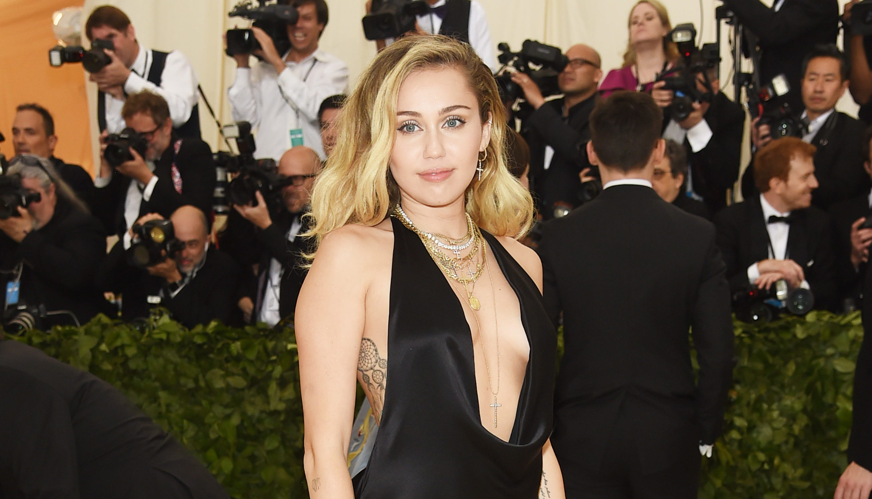 NEW YORK, NY - MAY 07: Miley Cyrus attends the Heavenly Bodies: Fashion & The Catholic Imagination Costume Institute Gala at The Metropolitan Museum of Art on May 7, 2018 in New York City. (Photo by Jamie McCarthy/Getty Images) ORG XMIT: 775160910 ORIG FILE ID: 955762624
