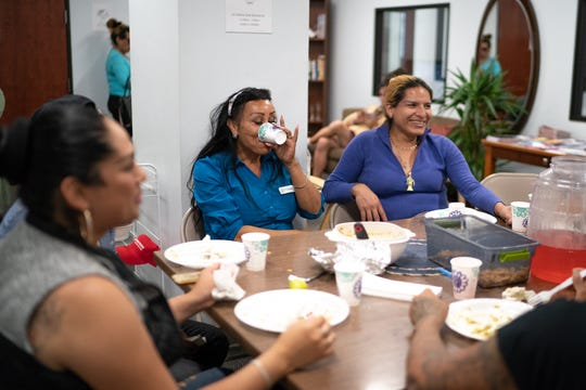 Clients of the TransLatin@ Coalition in Los Angeles eat lunch in the coalition's building. News21's investigation found that Latinos and LGBTQ people are hesitant to report hate crimes, in part because they mistrust police.