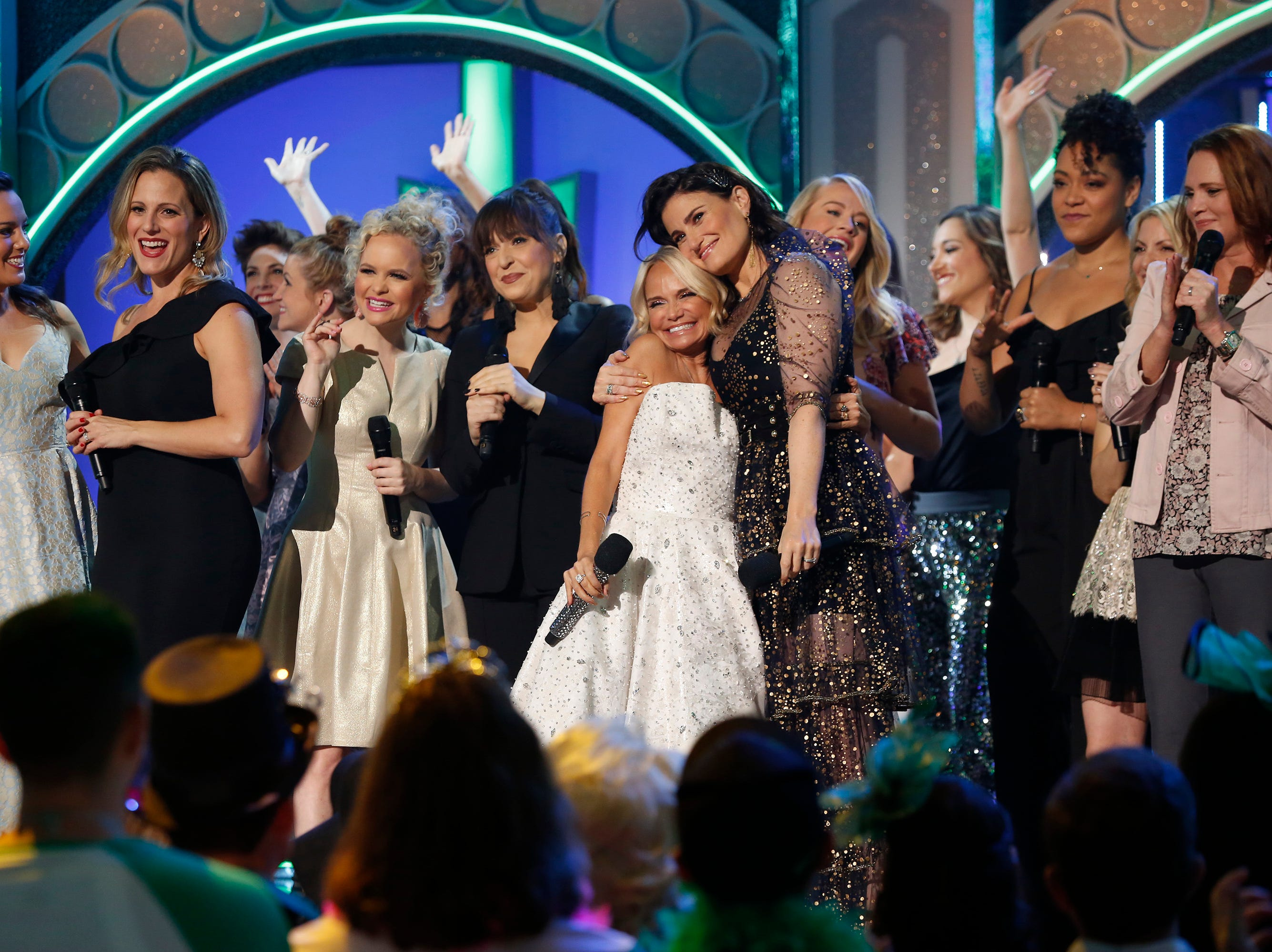 "This image released by NBC shows Kristin Chenoweth, center left, embracing Idina Menzel from the Halloween-themed TV special ""A Very Wicked Halloween: Celebrating 15 Years On Broadway,"" airing on NBC on Oct. 29 at 10pm ET. Chenoweth and Menzel were original stars of the Broadway production. (Eric Liebowitz/NBC via AP) ORG XMIT: NYET301"