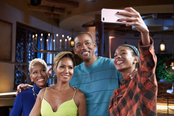 Jada Pinkett Smith and husband, Will Smith, center, with her mom, Adrienne Banfield-Jones and their daughter, Willow Smith.
