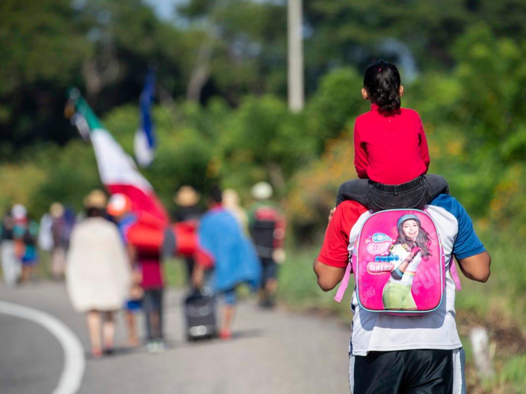 A small child gets a lift as the caravan procedes to Santiago Niltepec, Oaxaca, Monday.