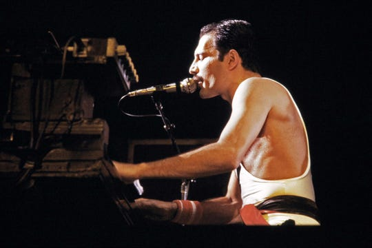 Freddie Mercury, pictured performing in Paris in 1984, had relationships with women and men throughout his life.