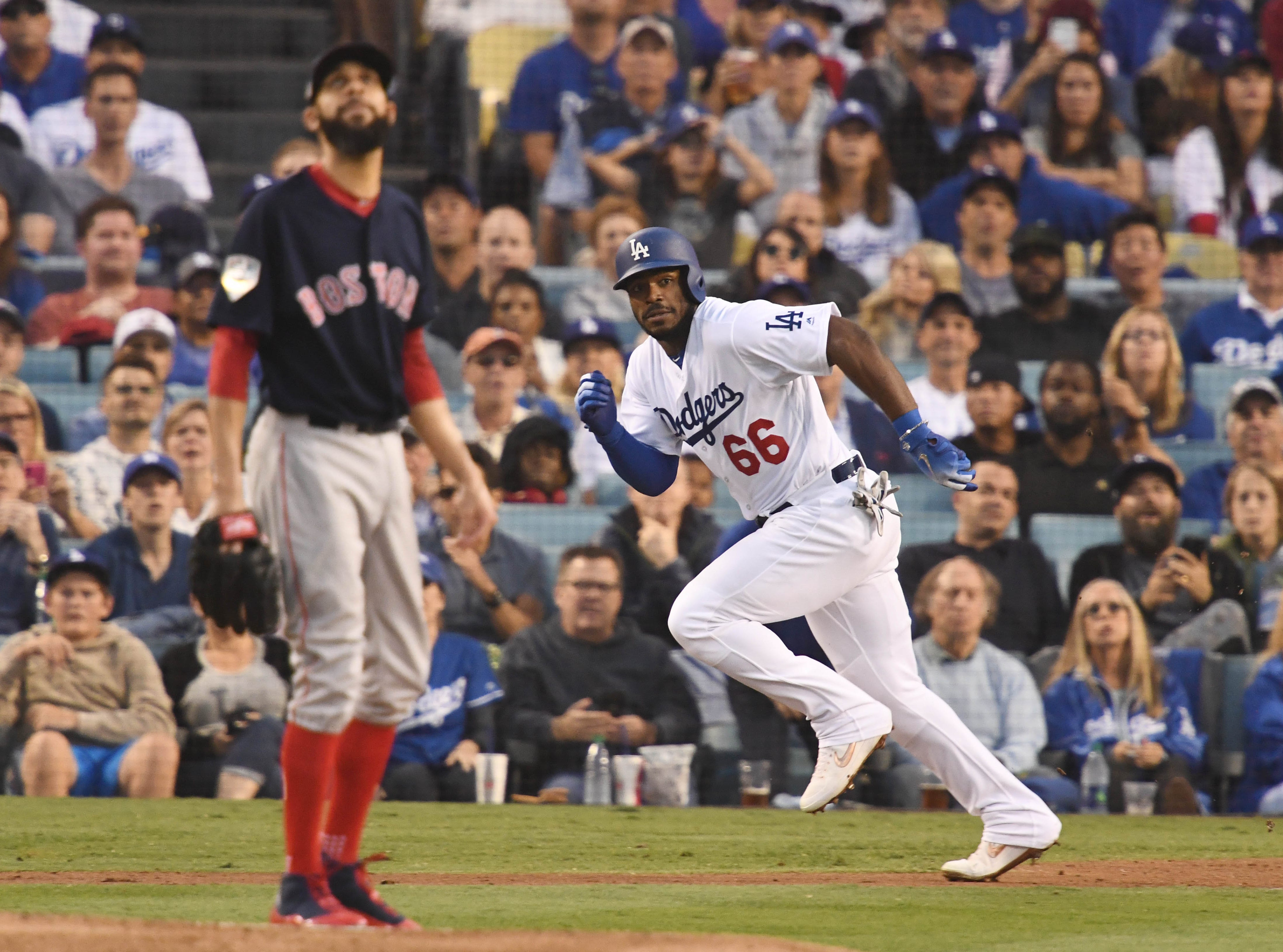 Game 5 at Dodger Stadium: Yasiel Puig hits   a single in the second inning.