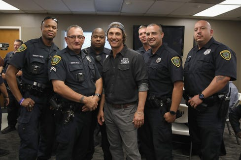 Matthew McConaughey takes photos with Houston's Police Department officers during Wild Turkey gives back 2018 with Matthew McConaughey on October 28, 2018 in Houston, Texas.