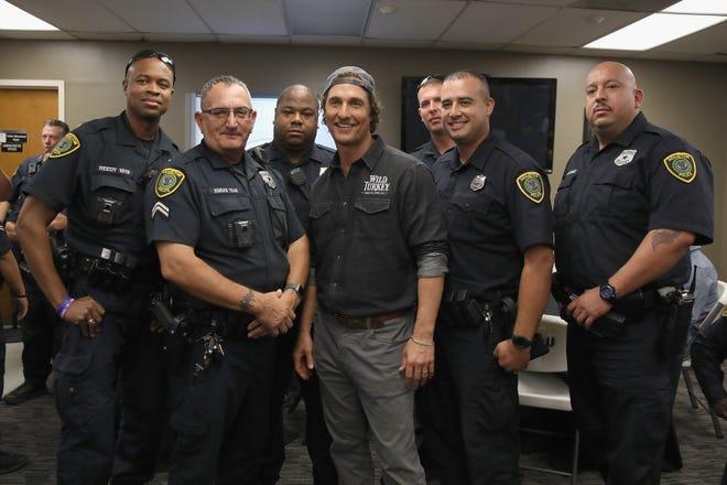 Matthew McConaughey takes photos with Houston's Police Department officers during Wild Turkey gives back 2018 with Matthew McConaughey on October 28, 2018 in Houston, Texas.