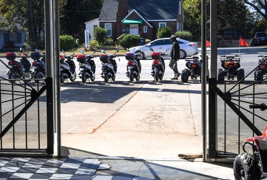 A man walks by a line of new mopeds for sale at Hot Shot Cycles on South Murray Avenue in Anderson in October. Owner Paul Abercrombie said he has been selling mopeds since 1970, and says new laws for riders should be helpful.