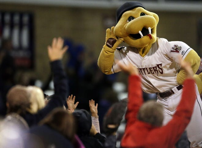 Wisconsin Timber Rattlers mascot Fang interacts with fans at Fox Cities Stadium in Grand Chute on Aug. 29, 2018.