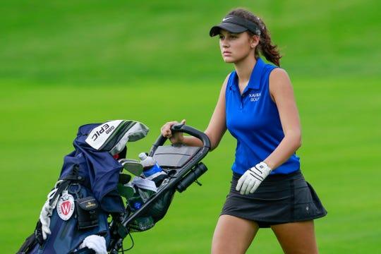 Xavier's Lauren Haen walks a fairway during the second round of the WIAA state golf tournament.