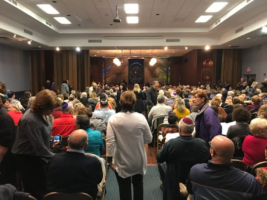 Attendees packed the Monmouth Reform Temple in Tinton Falls Monday night for a multi-faith vigil.