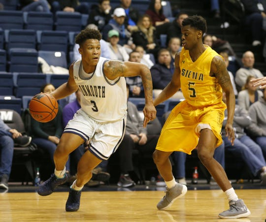 Monmouth guard Deion Hammond (3) drives to the basket against Siena Saints guard Kadeem Smithen (5) during second half at Ocean First Bank Center.