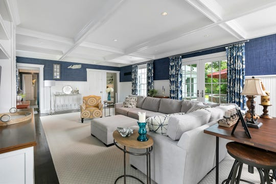 The family room features coffered  ceilings and customized French Doors.