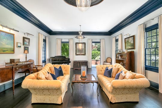 Living room features amazing hardwood floors and decorative crown molding.