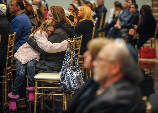 A girl grieves at a vigil for victims of the Tree of Life Synagogue at The Marlboro Jewish Center in Marlboro on Oct. 29, 2018.
