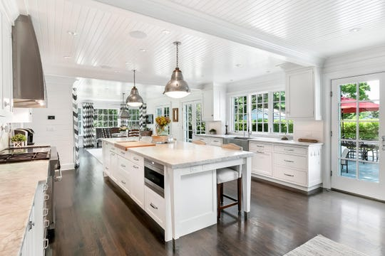 The kitchen offers a huge center island and paneled ceilings.