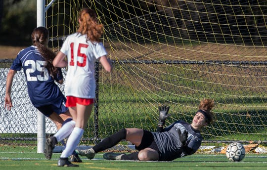 Marlboro's Victoria Tzitzis blasts ball by Manalpan gorlie Birnna Branagan during first half action. Manalapan Girls Soccer vs Marlboro in Marlboro, NJ on October 30, 2018.