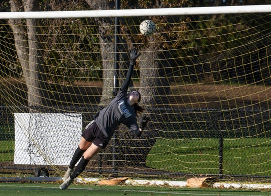 Manalapan goalie Brianna Branagan can't reach a shot that is blasted into goal by Marlboro's Victoria Tzitzis for first goal of game.  Manalapan Girls Soccer vs Marlboro in Marlboro, NJ on October 30, 2018.
