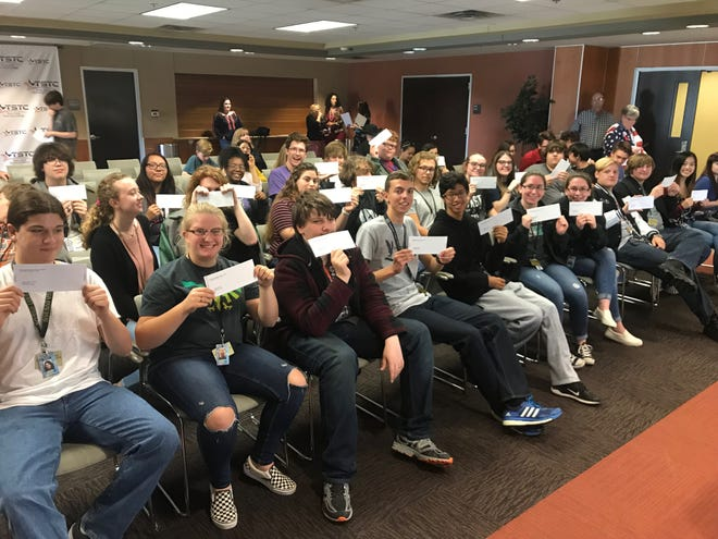 Abilene ISD's Academy of Technology, Engineering, Math and Science students hold up their checks Tuesday. The Dodge Jones Foundation, which provided the student payouts, is going away, as is the student payments, according to the school district.
