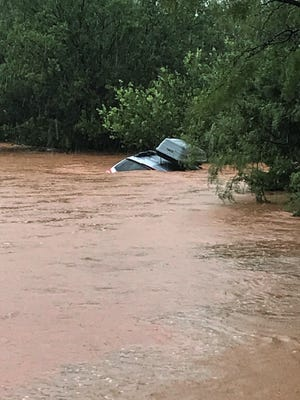 After his truck stalled in high water on Sept. 7, 2018, Sgt. Elias Guerra St. with the Taylor County Sheriff's Office waded in chest-hire water on County Road 283 to calm a woman holding an infant while on top of a car swept off the road until further help could arrive.