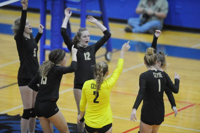 Members of the Clyde volleyball team celebrate a point during a bi-district playoff match against Early on Oct. 29, 2018 at Coleman High School.