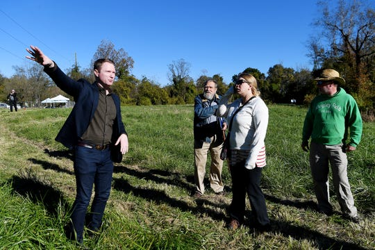 John Ridenour, an associate with Nelson Byrd Woltz Landscape Architects, takes a group on a tour of the empty 5-acre on Amboy Road Oct. 29, 2018. The grounds, which once housed a junkyard, will become Karen Cragnolin Park.