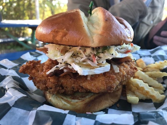 The Asheville fried chicken sandwich comes brushed with hot honey and topped with brie and apple slaw.