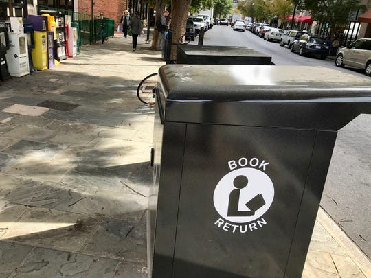 Buncombe County installed a new book drop recently in front of Pack Memorial Library downtown. The iconic green cylindrical book drop was taken to the landfill.