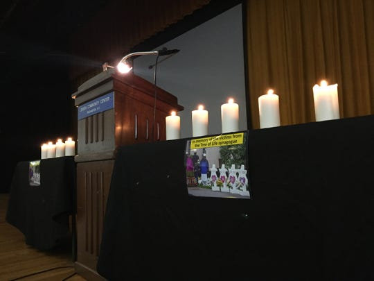 Eleven candles were lit in honor of Saturday's shooting at the Tree of Life Congregation Synagogue in Pittsburgh during Monday evening's vigil at the Jewish Community Center of Binghamton for the victims of Saturday's shooting at the Tree of Life Congregation Synagogue in Pittsburgh.