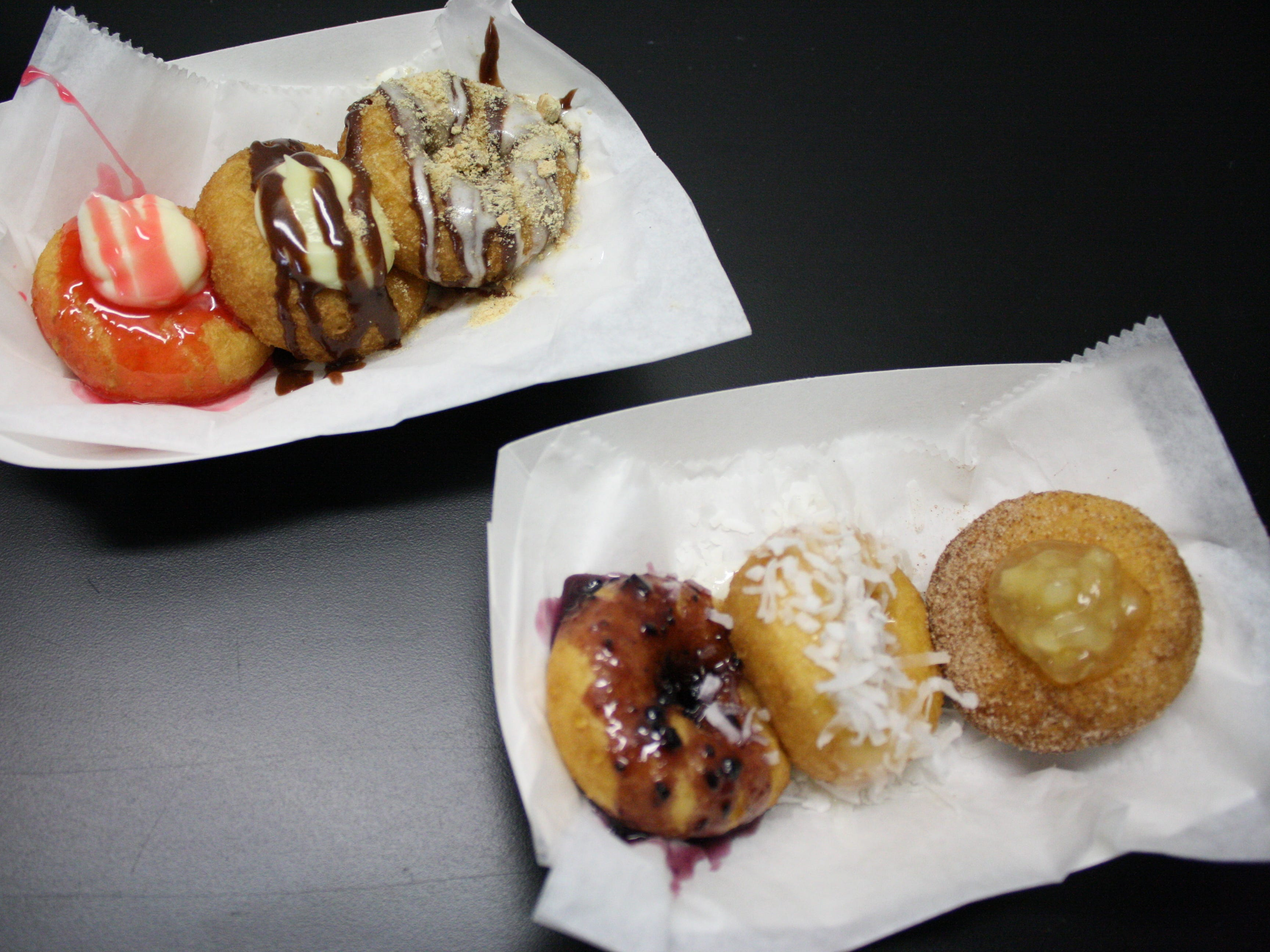 The JukeBox Donut Shop creates made-to-order donuts and other baked goods inside a mobile food truck. The truck can be seen at local events, festivals and private functions.