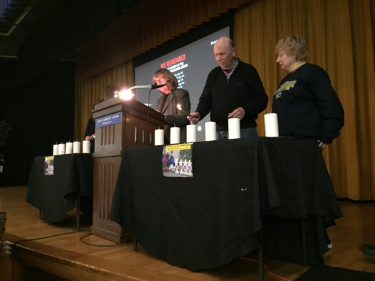 Sandy and Dennis Foreman, community members from Pittsburgh, light candles  at Monday's vigil.