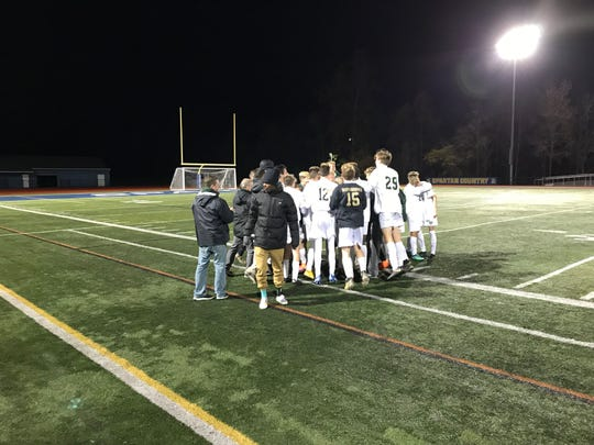 Vestal's boys in the aftermath of Monday's 2-1 win against Maine-Endwell for the Class A soccer championship.