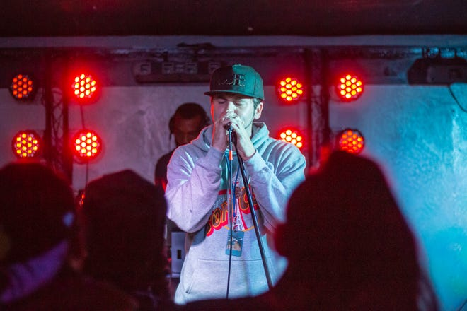 David Olivas performs at a recent show. Fans of the hip hop artist believe he may have inspired a song in a recent Netflix special by Adam Sandler.