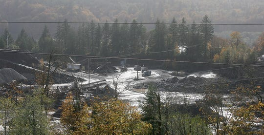 Trucks rumble across the Kitsap Reclamation and Materials quarry in Gorst on Friday, Oct. 26, 2018.