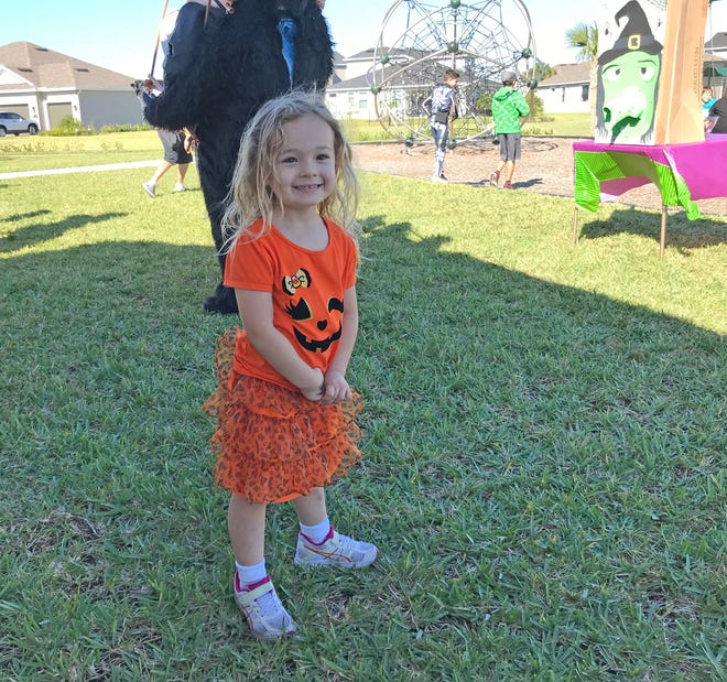 Isabella enjoys a neighborhood Halloween party last weekend.
