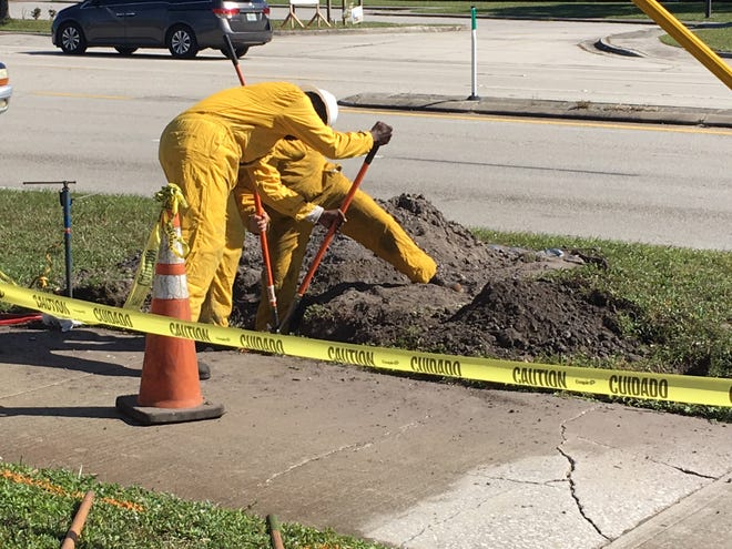 Florida City Gas workers repair a gas leak on Babcock Street on Oct. 30, 2018.